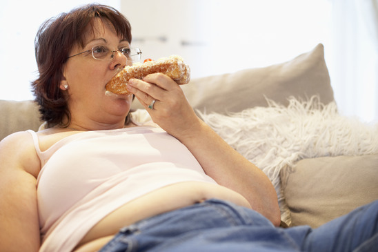 photodune 333349 overweight woman relaxing on sofa xs Tummy Tuck Plastic Surgery